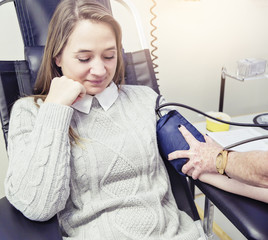 Female blood donor has her blood pressure checked