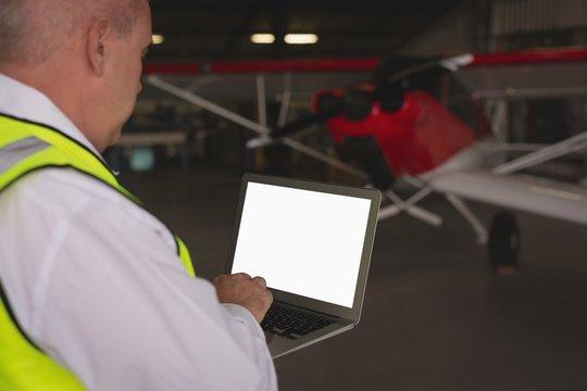 Crew member using laptop