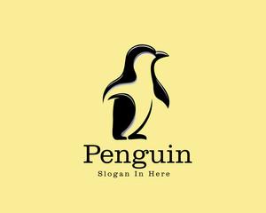 walking penguin animal logo vector