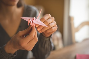 Woman preparing a paper craft at home