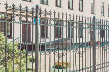 Urban city apartment building exterior with decorative fence. Old town house