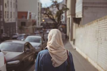Hijab woman standing on sidewalk