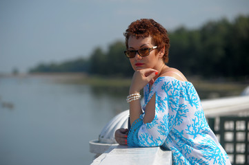 happy woman with short hair in sunglasses