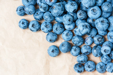 Fresh blueberry on craft paper background. Blueberries texture close up