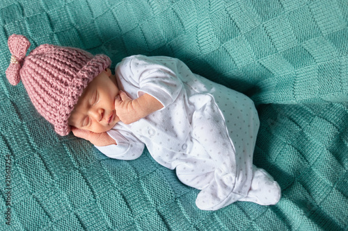 4817a8e3a Sleeping baby girl with pink woolean hat. Newborn caucaisan baby ...