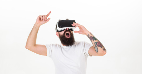 Man with beard in VR glasses dancing, white background. Virtual party concept. Hipster on shouting face having fun in virtual reality. Guy with head mounted display dance in virtual reality