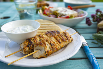 Delicious grilled chicken souvlaki, traditional Greek dish.