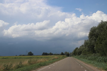 Big wall cloud above the fields in Overijssel in the Netherlands with thunderstorms coming up