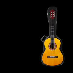 Musical instrument - Acoustic classic guitar from above on a hard case black background isolated