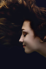 fashion portrait of girl,young woman face profile in water