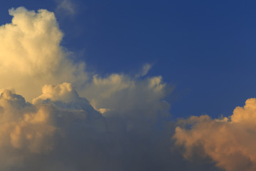 Cumulus at sunset. Sky and clouds background.