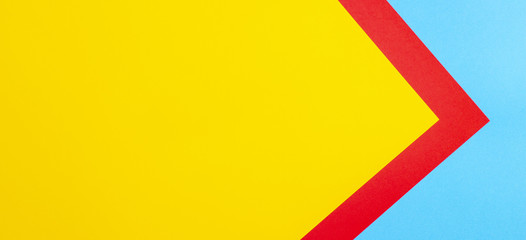 Color papers geometry flat composition background with yellow red and blue tones