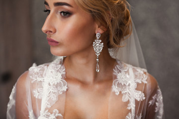 The gentle morning of the bride. Wedding.Jewellery.Portrait of bride
