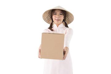 Beautiful vietnam women wearing Ao Dai vietnam traditional dress holding a box isolated on white background.