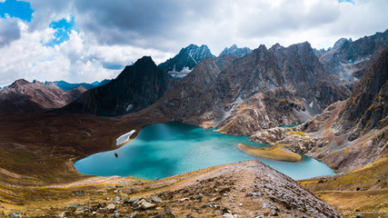 The breathtaking view of Krishansar lake in dry season under a cloudy weather from Gadsar Pass (4,080m), Kashmir The Great Lakes Trek, India