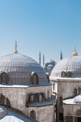 Famous Blue Mosque (Sultanahmet Camii) with domes of Hagia Sophia in foreground, view from Hagia Sophia's window, The old town of Istanbul, Turkey