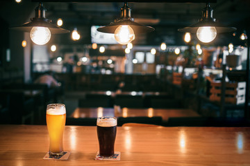 Light and dark beer in glasses on the table in the bar