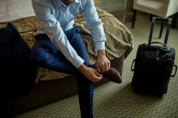 Businessman tying shoes laces