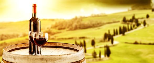 Wine photo of barrel and Tuscany landscape