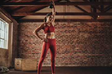 Fitness woman doing exercising with kettle bell