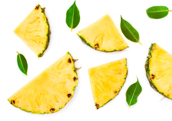 Sliced pineapple and green leaves pattern. Tropical pineapple summer fruit  isolated on white background. Top view.
