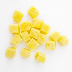Fresh pineapple cube slices isolated on the white background. Pineapple chunks close up.