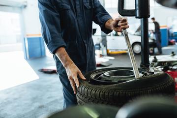 Mechanic working on tire changing machine