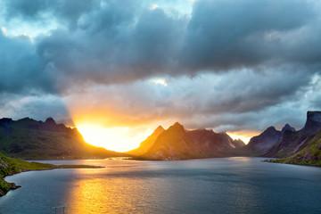 Fotomurales - Sharp mountain peaks of Lofoten Islands at sunset, Norway