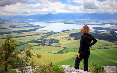 woman and liptov panorama on liptovska mara water lake reservoir and low tatras