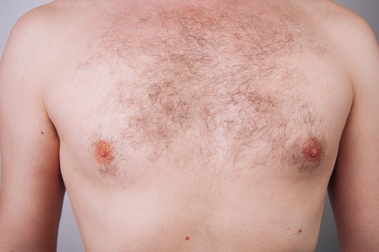 Chest of a man before trimming chest hair