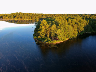 Aerial drone view of Lean to Campsite in the Adirondack mountains with a campfire burning.