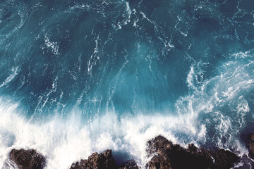 view of dark sea landscape background, water splashing waves on the rocks
