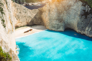 Fototapeta Shipwreck on Navagio beach with turquoise blue sea water surrounded by huge white cliffs. Famous landmark location on Zakynthos island, Greece obraz