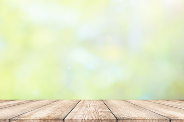 Empty wood table top with abstract natural bokeh background