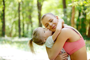Love and happiness. Mother and daughter kissing and hugging. Family, Bonding, Childhood, Parenting