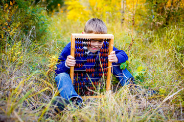 boy in a blue jacket keeps old scores and hides behind them, the school theme