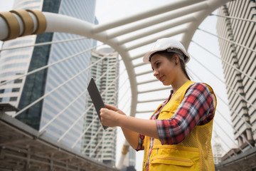 woman engineer check constructed plan from tablet