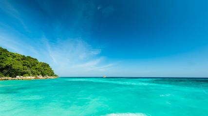 Wonderful turqoise sea at Andaman sea, Beautiful beach and gentle wave at Surin Island, Thailand Wall mural