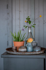 Retro still life: flower in a vase  - photo with vintage color toning.