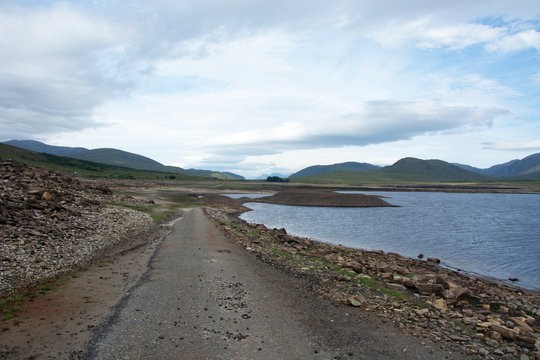 Looking westwards after crossing a very muddy section of a road which is normally submerged under Loch Glascarnoch