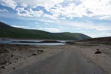 Looking eastwards while standing on a road that is normally submerged under Loch Glascarnoch