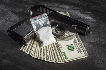 Drugs in a plastic bag with a bunch of dollars and a gun