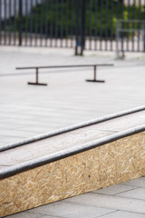 Grind box with skate rails in skatepark outdoor