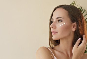 skin care concept. close up portrait of beautiful woman with cosmetic cream