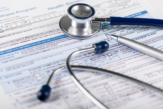 Stethoscope on Health Insurance Document / Medical Form