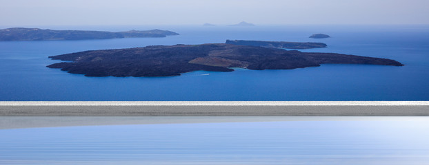 Summer vacation in Greek islands, Santorini, Greece. Volcano view over a swimming pool, banner.