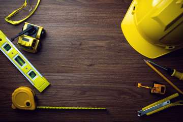 under construction engineer tools mechanicle top view on wood background