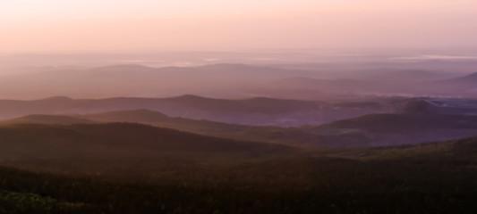 Fotorolgordijn Chocoladebruin Blurred background - mountains and valleys in the dawn haze