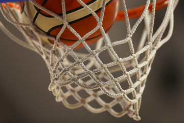 Basketball net and ball close-up