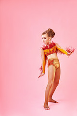 Contemporary dance. A little girl performs a complex acrobatic dance. Modern dance on a bright colorful background.